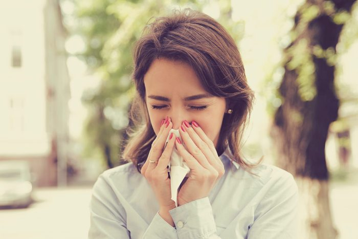 Woman,with,allergy,symptoms,blowing,nose