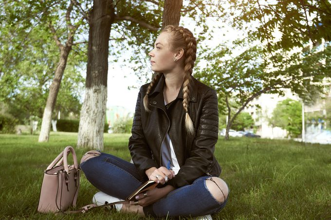 Natural home remedies for anxiety, a woman sitting in a park