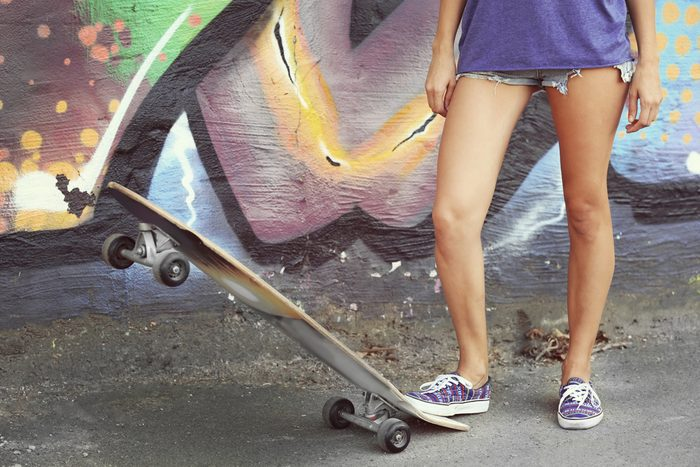 fun ways to stay in shape_ woman with skateboard
