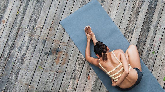 morning yoga routine, woman on yoga mat