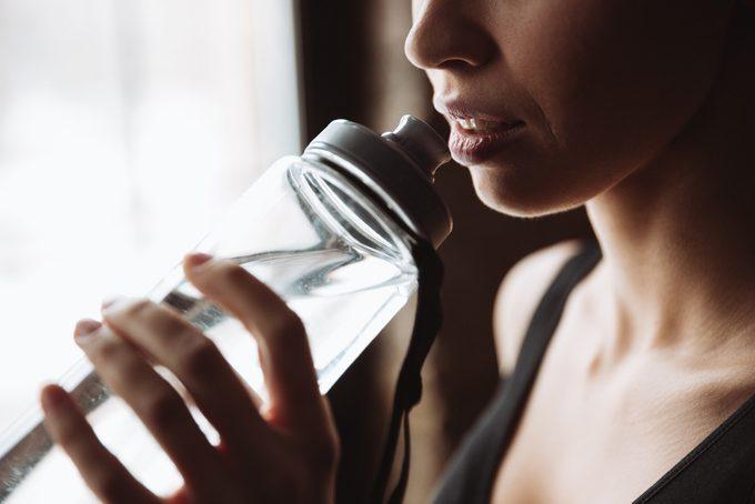 woman drinking water_ increase metabolism