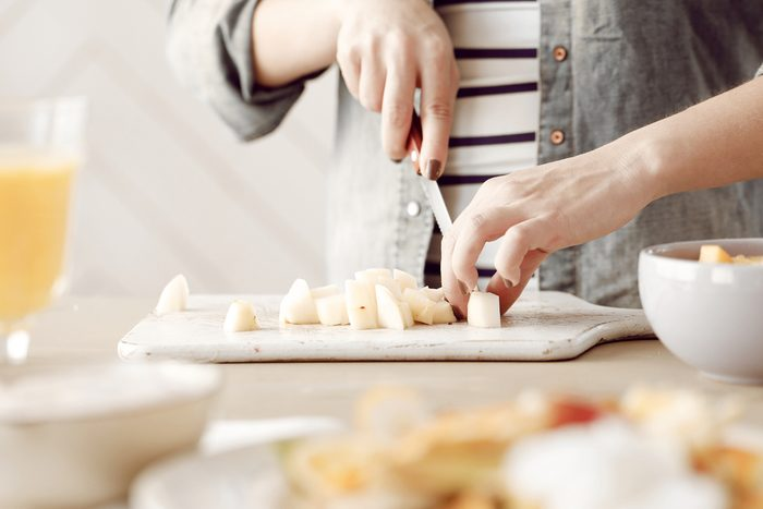 woman chopping food_ weeknight food prep tips