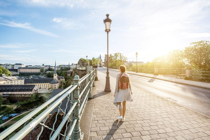 lose weight walking - woman walking on bridge