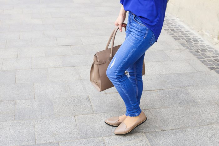 women hurt their health_woman with jeans