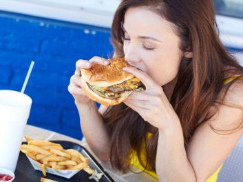 woman eating burger habit