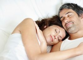 happy couple in bed sleeping