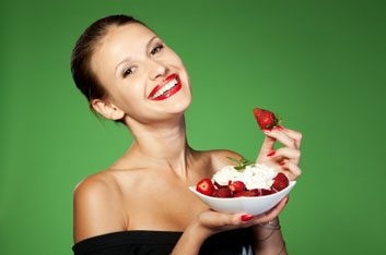 woman eating strawberries