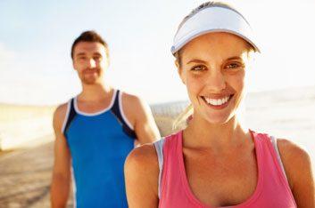 man and woman exercising