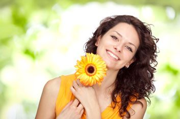 happy women outdoors with flower