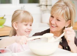 woman baking with child