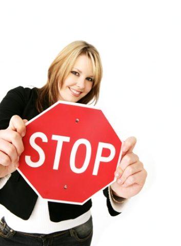 istock_woman_stop_sign-57622812.jpg