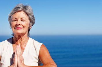 older woman meditating relax