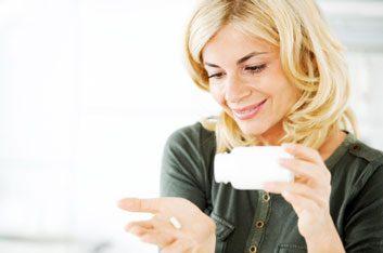 woman taking vitamins pills