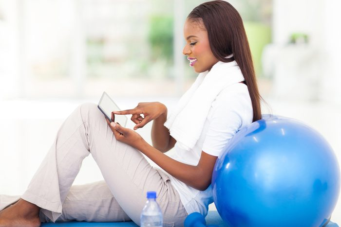 Woman-looking-at-fitness-apps