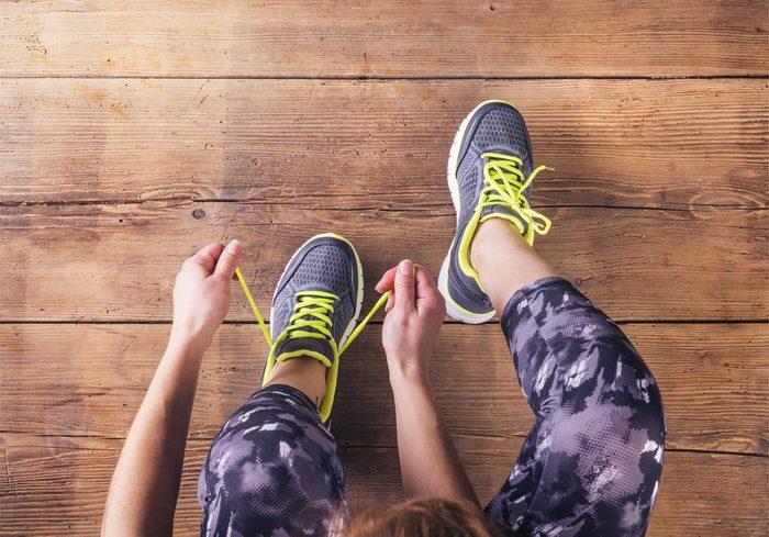 woman-tying-shoe