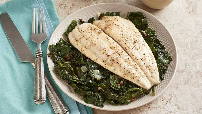 Delicious-looking plate of white fish and kale