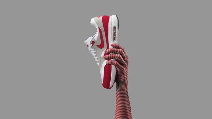 Hand holding Nike Air Max 1
