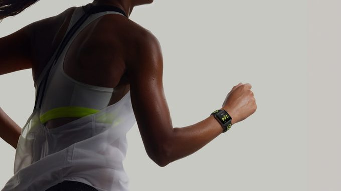 woman running with Apple Watch