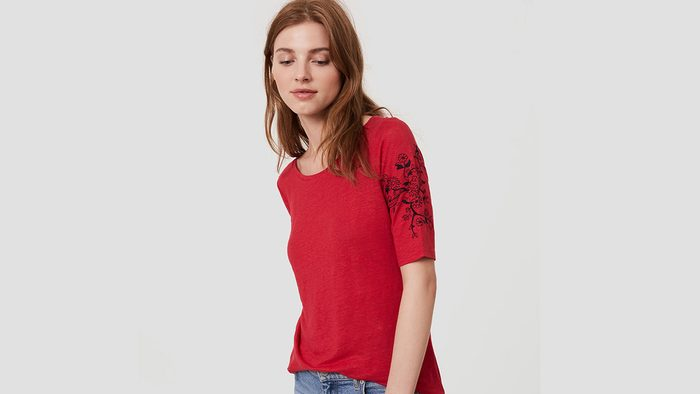Red fashion tee with embroidery on the sleeve