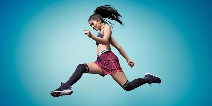 Kylie Jenner mid-stride in the air