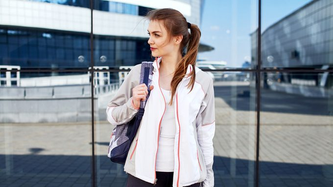 best workout gear for women, a woman holding her gymbag in the street