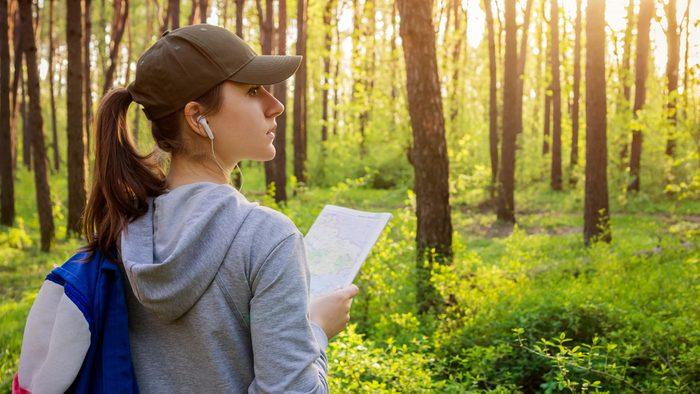 exercise prescription for alzheimer's: woman doing a park hike.