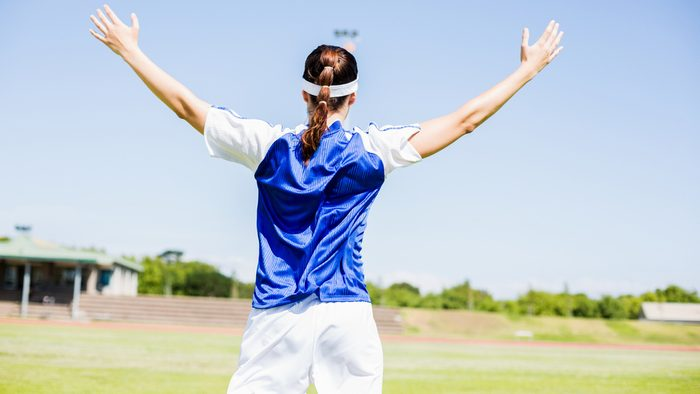 summer sports injuries, female soccer player cheering on the field
