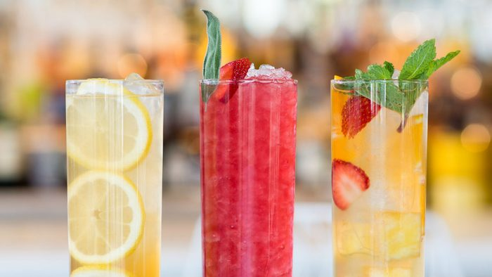 Iced Tea Cocktails, two cocktails and a mocktail served in Collins glasses
