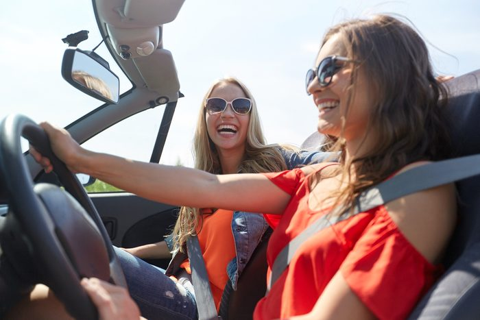 woman driving with friend _ stress-free commute
