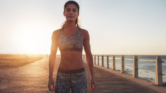 staying motivated in summer, woman looking proud in her workout wear