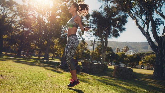 staying motivated in summer, woman doing jump rope