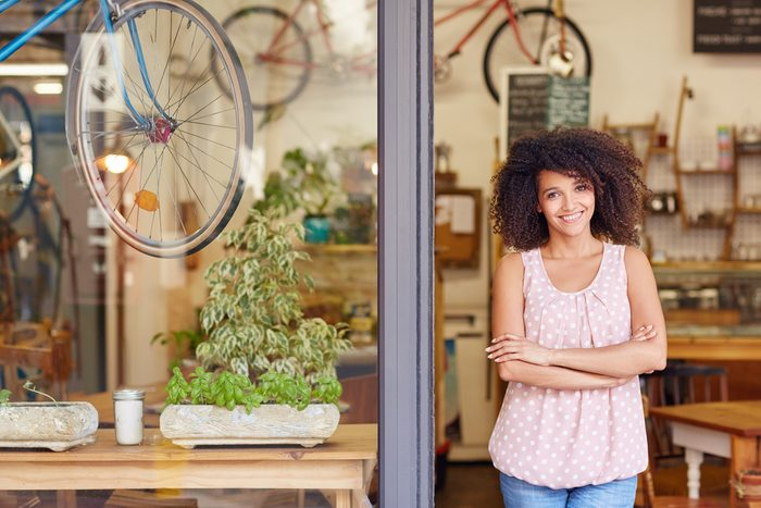 next overnight success_hardworking woman standing in front of store
