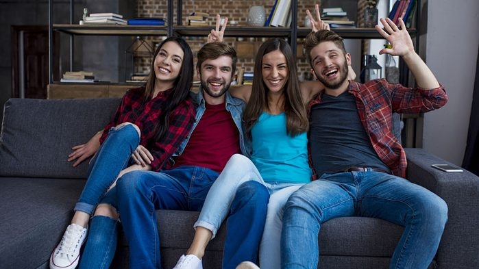 home giving you anxiety happy home, a group of people smiling on a couch