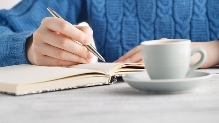 Weight loss tips, woman writing in her food journal