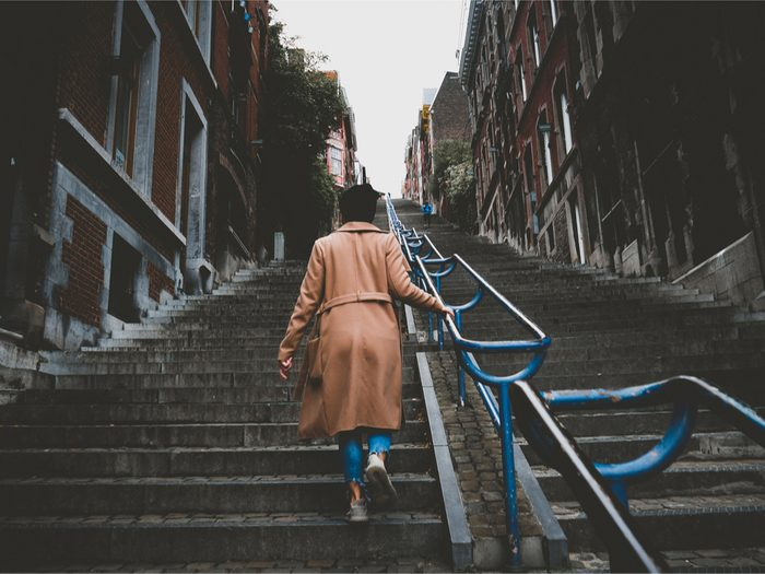 walk more walking wednedays, a woman walking up city stairs