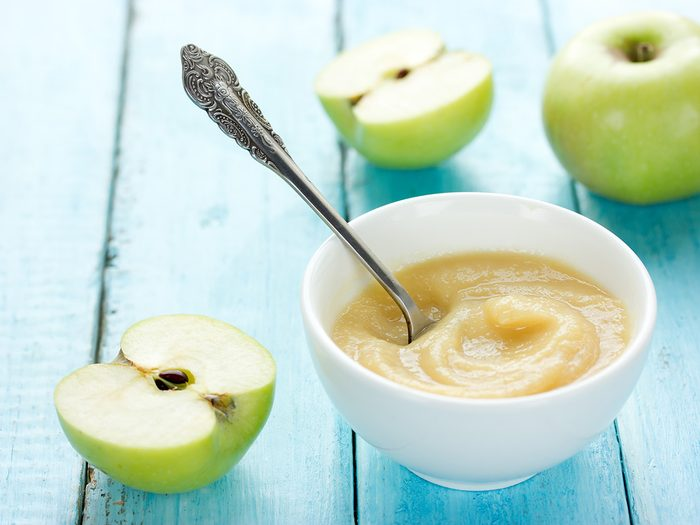 Butter substitute, bowl of applesauce and fresh apples