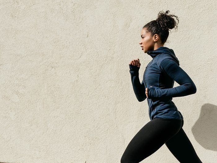 High cholesterol, fit woman running outdoors