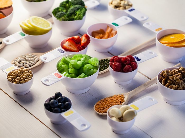 Lose weight, food in measuring cups