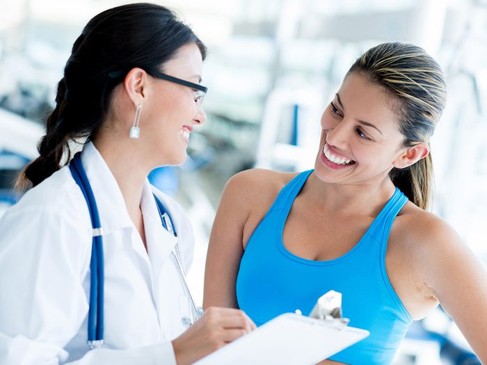 Health trend, a doctor talking to a woman in workout clothes