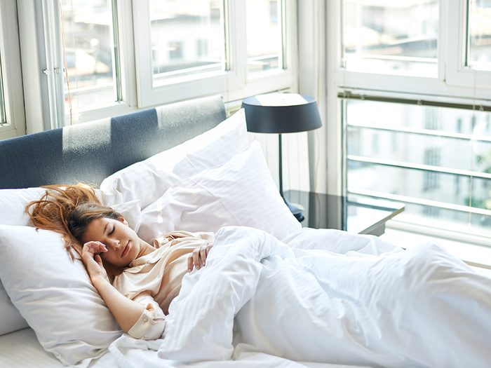 Health trends, a woman sleeping in a brightly lit room