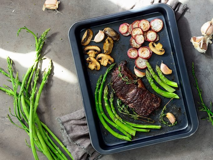 How to eat healthy, cooking sheet with beef and vegetables laid out on it
