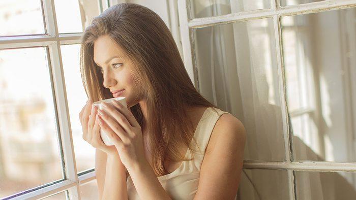 Happy People, woman holding a coffee mug