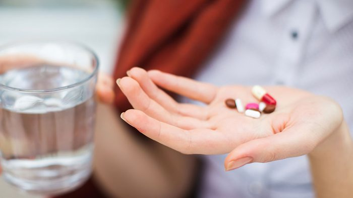 Breast Cancer Advancements, woman taking pills