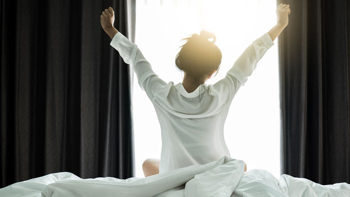 Sleep products, woman getting up in the morning
