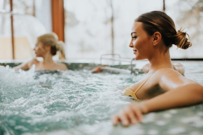 relaxing in hot tub friends