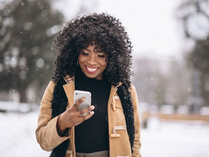 woman with phone in winter