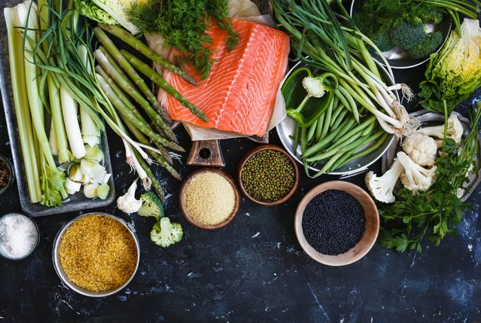 Raw fish veggies cereals. Salmon fish and green vegetables leafy dry soybeans bulgur cereal black quinoa dieting vegetarian ingredients food dinner