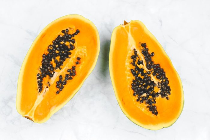 Fresh papaya cut in a half, top view