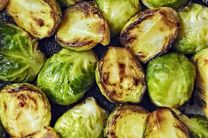 close up of rustic crispy fried brussels sprouts food background