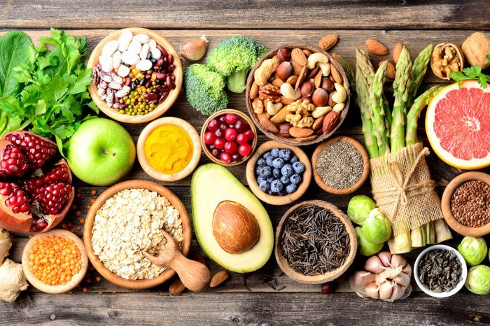 Superfoods, vegetables, fruits, seeds, legumes, nuts and grains for vegan and vegetarian eating. Clean eating. Detox, dieting food concept. Top view .